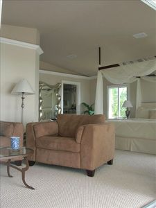 Partial View of Master Bedroom and Sitting Area with sofa & TV Armoire