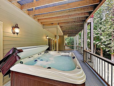 Deck - Treat yourself to a restorative soak in the bubbling hot tub on the deck.