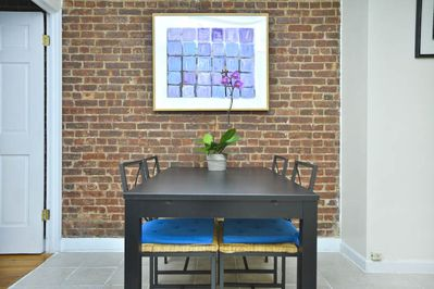 original exposed brick wall in dining area