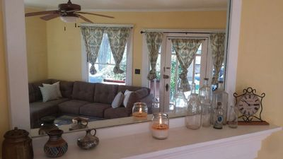 Living room through mirror on mantle