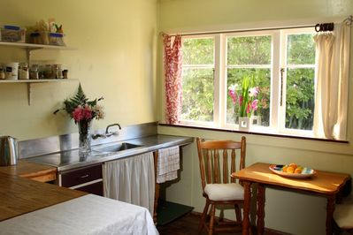 Light and airy vintage kitchen with view to garden.