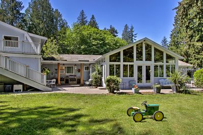 This Poulsbo home boasts a private oasis with professional landscaping.