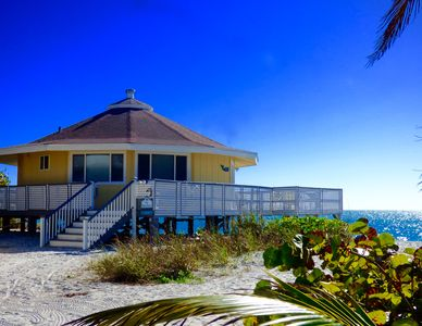 Photo for A Charming Island Original Right ON the Beach, Renovated & GOLF CART voucher!