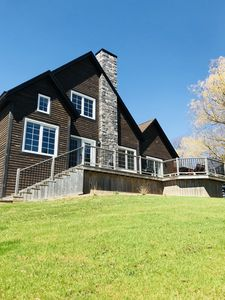 Gorgeous chalet style home with lots of privacy set in country setting
