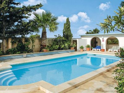 Photo for A welcoming villa with privacy and a large pool, located near several popular resorts
