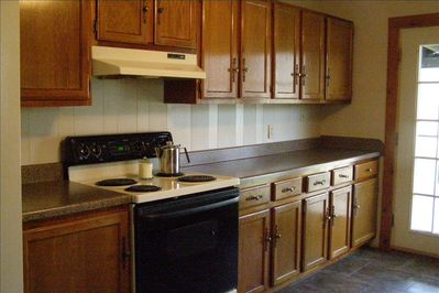 Kitchen 12'X15', Microwave, Stove, Refrig., Dishwasher, Coffee Maker, Cookware.