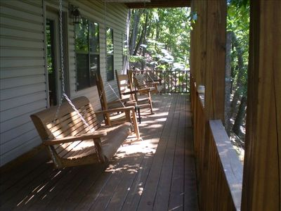 The lower deck with rockers, porch swings, and seasonal views.