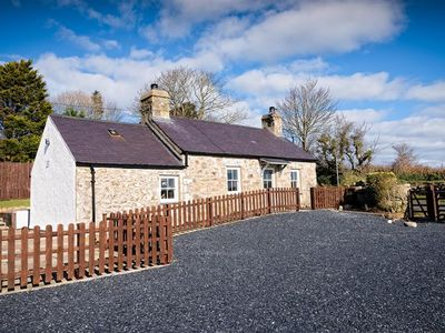Photo for This traditional stone character cottage has been tastefully refurbished and features a cosy living