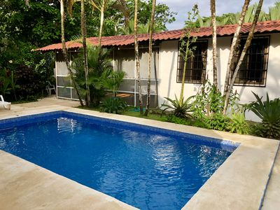 Photo for CARIBBEAN BEACHFRONT with Amazing Amenities! (Pool, A/C, WIFI, Cable, Phone)