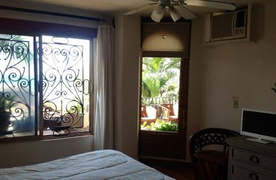 Master bedroom with A/C unit, flat screen TV and ocean view