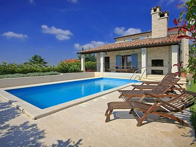 Photo for Modern villa with private pool, each bedroom suite, garden