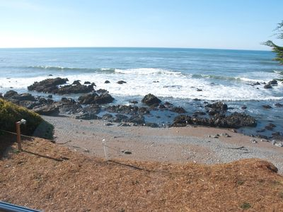 Photo for Listen to crashing waves in oceanfront property.