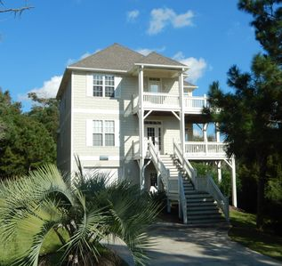 Oceanside home with large private pool and golf cart for easy beach access.