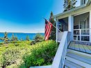 Back Porch - A screened back porch offers wonderful views of the pristine coast.