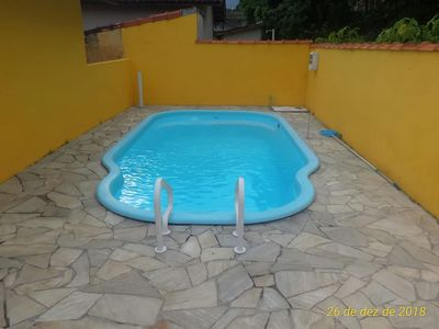 Photo for house in Bertioga beach with pool and barbecue.