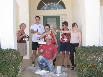 Our family after finishing painting the home with the tools of their trade.