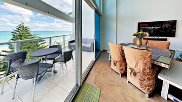Balcony with beach a stone throw away!