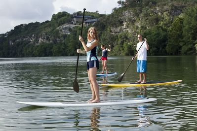 Fun on the Lake - Enjoy some Stand Up Paddle Boarding on Lake Austin. ARRIVE will set it up for you!