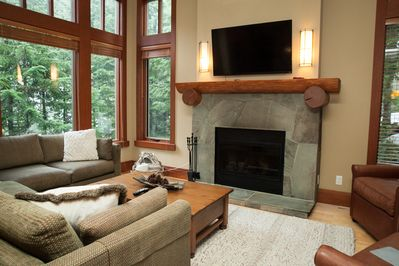 Living room with gas fire place and large sectional