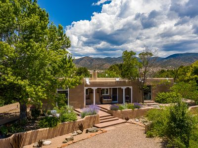 Photo for Spectacular mountain & mesa views surround this tranquil 5 acre Santa Fe adobe.
