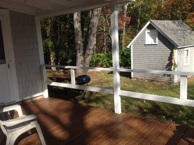 Covered Deck Overlooking Back Yard