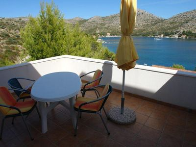 Photo for One bedroom apartment with terrace and sea view Skrivena Luka (Lastovo)