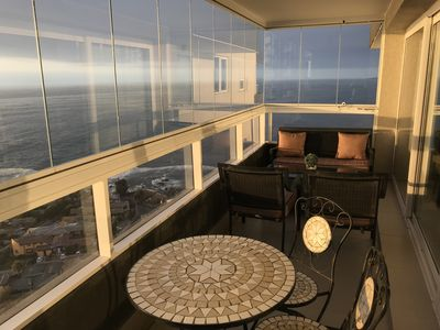 Ocean view terrace with folding glass closure system