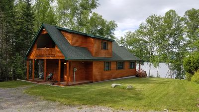 Photo for Nice log cabin with flat lawn to waterfront