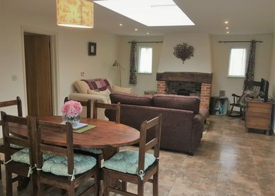 Open plan living room, dining for 6 and kitchen with bifold doors to the garden