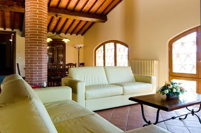 Spacious living room with comfortable leather sofa