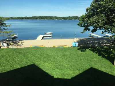 Gorgeous view of beach.  4 docks, 4 paddle boards, raft, spacious lawn & beach!