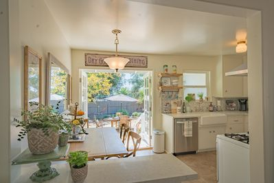 Bright clean and updated kitchen leading to the private yard