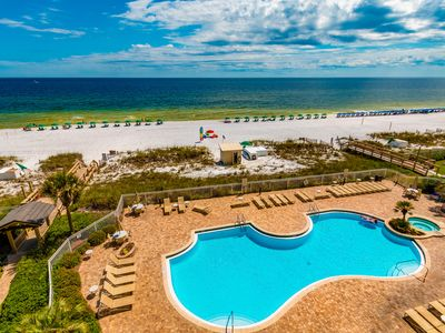 Photo for Great gulf views with convenient beach access and shared pool!