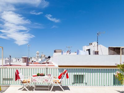 Photo for Central Studio Apartment Close to Beach with Rooftop Terrace, Andalusian Courtyard & Wi-Fi