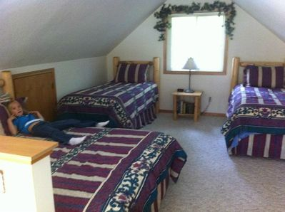 Loft sleeping quarters.1 queen bed and three twins (adding extra twin)