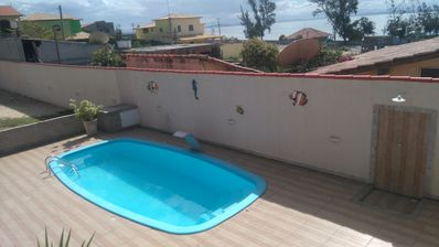 Photo for House with pool on beach street, barbecue, Wifi, Sky