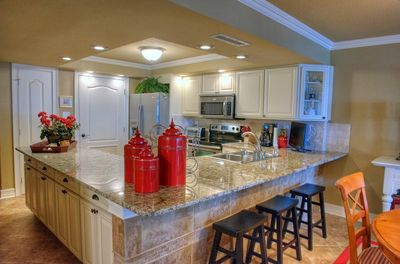 Remodeled kitchen with granite counters and new cabinets.