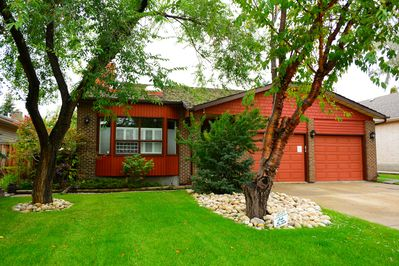 Lovely Mature well-kept landscaping with large driveway.
