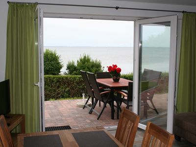 Photo for Meeresrauschen directly on the water - sea view holiday house with 2 apartments in Neuendorf / Rüg
