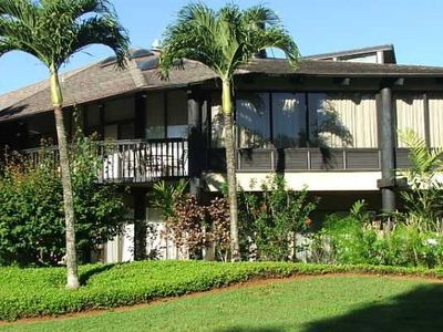 Tropical landscaping surrounds this 2nd floor open unit.Walk to beach and pool