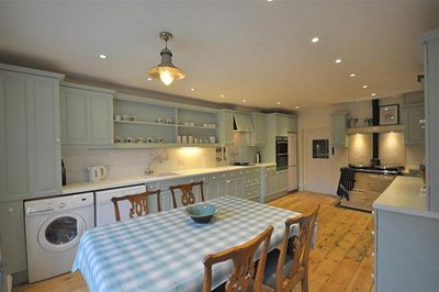 Large country kitchen with Aga and hob/oven dining table for 6