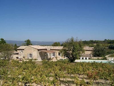 Photo for Prestigious farmhouse with heated pool in the heart of Luberon