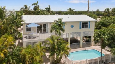 Photo for Ocean Front with private pool, gorgeous sunsets from gazaebo, boat dock