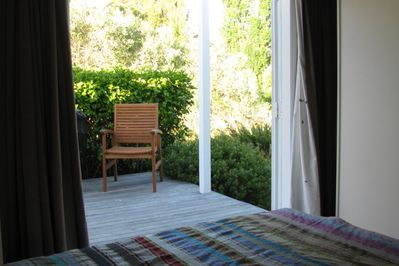 Double bedroom with view to back deck and garden