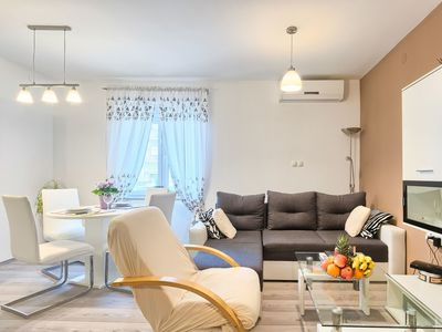 Photo for Lovely apartment for 4 people with A/C, WIFI, TV and pets allowed