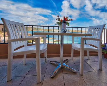 Photo for SEAFRONT  APARTMENT  ON   SEA WATER'S  EDGE -  HEAVENLY SEAVIEWS, BEACH & SUNDECK LIDO RIGHT ON YOUR DOORSTEP
