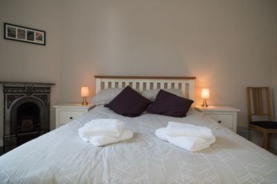 Master bedroom with stylish king size double bed