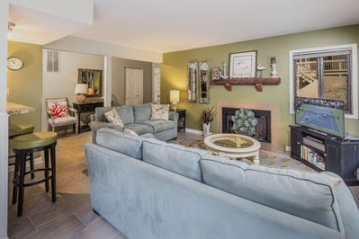 Living Room - Welcome to Hilton Head Island! With an open-concept layout and plenty of seating for your party, this area acts as the social heart of the home.