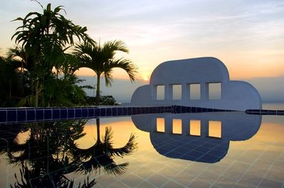 Infinity plunge pool at sunset, from your private top floor deck