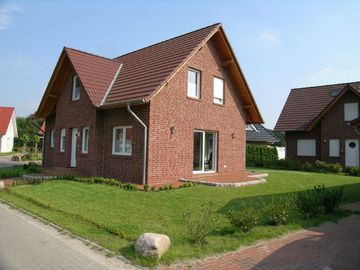Holiday house on the golf course - 50% discount on green fees - ideal for families